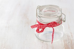 empty glass jar on white wooden background